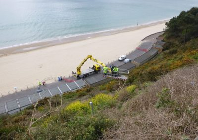 A second, larger cherry picker was required to reach the top of the cliff face