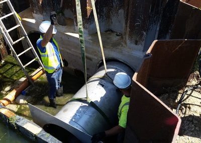 One of the flood valve's being lifted into place
