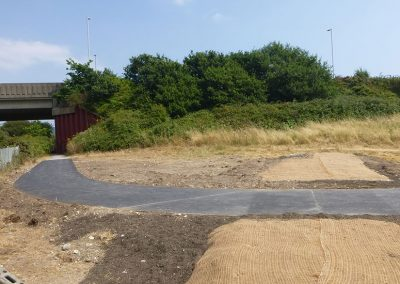 The geotextile covering will give some protection to the soil and seeds that have been sown while the vegetation is establishing; it's made from coconut fibre and will naturally rot away in time.