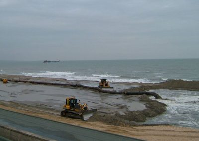Pumping material from the dredger through the onshore pipeline and into the bund