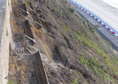 Partially excavated 1970s stabilisation measures that are being removed as part of the scheme