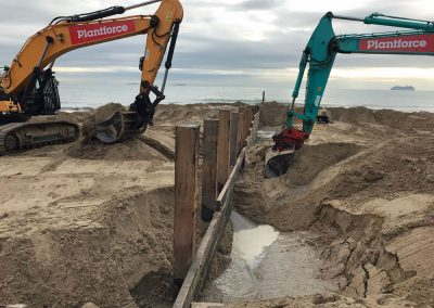 Excavating sand around the groyne