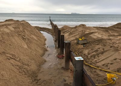 The planking of a new groyne begins from the top down
