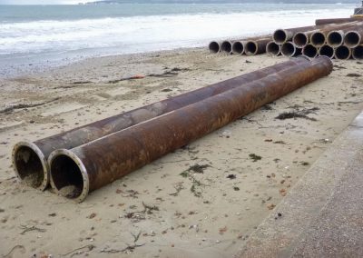 Sections of pipe will be stacked on the beaches