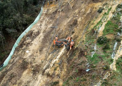 Trailer rig suspended from cliff top used for soil nailing
