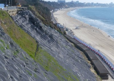 April: the hydro-seeded cliff face shows signs of vegetation